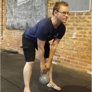 David Elcoate from Reboot perrsonal training swinging a kettlebell